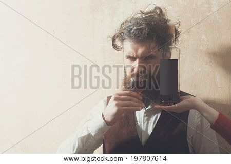 Man Drinking Glass Of Wine From Bottle On Female Hand