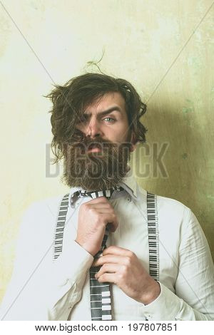 Hipster In Shirt And Suspenders With Musical Tie.