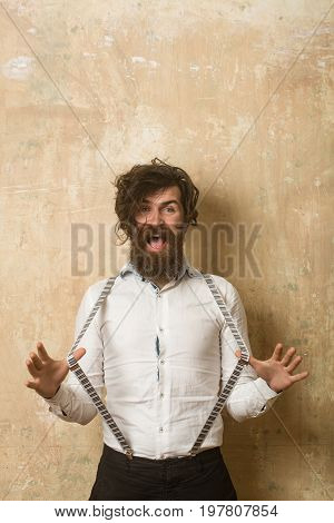 Guy Or Businessman At Textured Wall.