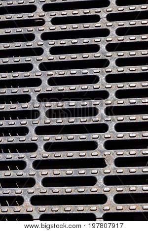 Heavy duty steel grating cover on sewer drain manhole .