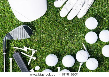 On a green lawn for a background lined with golf equipment there is a place for an inscription