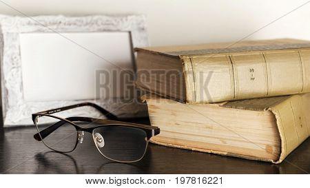 Soft Focus Vintage Glasses, Blur Books Stack On Wooden Desk In University Or Public Library Room Or