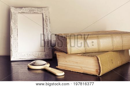 Vintage Book And Magnifying Glass On Wooden Backgroundas Background For Art Design. Selective Focus.