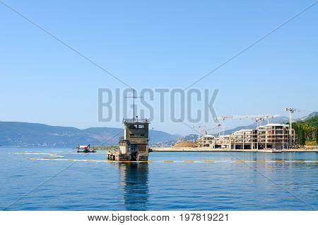 BAY OF KOTOR MONTENEGRO - SEPTEMBER 16 2015: Construction of new modern hotel on coast of Bay of Kotor Montenegro