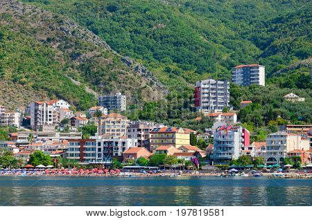 RAFAILOVICI MONTENEGRO - SEPTEMBER 19 2015: View from sea to popular resort village of Rafailovici (Hotel Obala Plus 3* Apartment Lux Tri Ribara 4* fish restaurant Tri Ribara) Montenegro