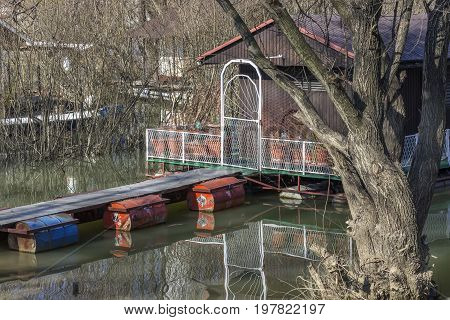 Small Wooden Houseboat With Bridge