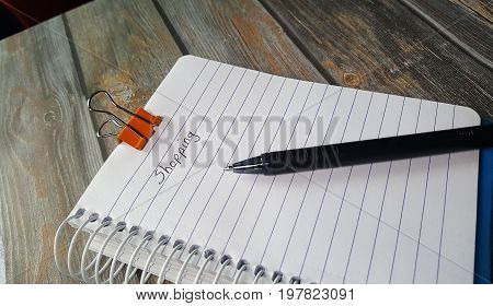 a note pad to use as a shopping list with black pen