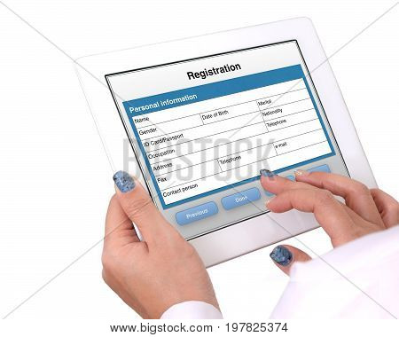 Someone's hands holding tablet that showed registration online form on white background.