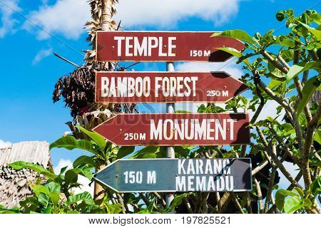 Signpost With Directional Arrows At Penglipuran Traditional Village In Bali, Indonesia