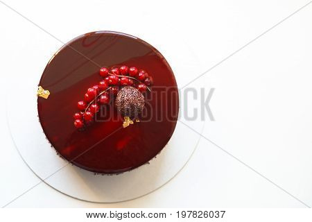 Ombre Marble Mousse Cake Decorated With Red Mirror Glaze And Berries. Modern Dessert. Natural Light