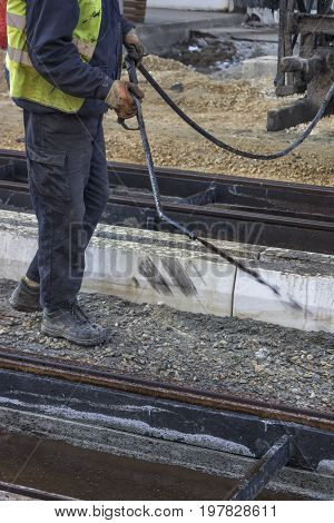 Road Worker Spraying Manually Bitumen Emulsion 2