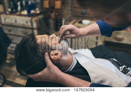 Barber Shaving Customer