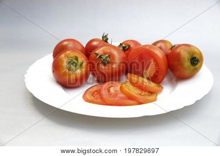 Tomatoes On White Background