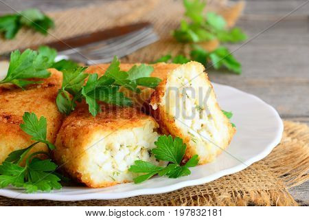 Vegetable cutlets with egg stuffing. Cutlets (zrazy) cooked from cauliflower and potatoes and stuffed with boiled sliced eggs. Rustic style. Closeup