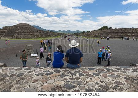 Teotihuacan State of Mexico Mexico - June 1 2014: People at the Avenue of the Dead in the Teotihuacan archaeological site in Mexico. Teotihuacan was one of the largest cities in the pre-Columbian Americas.