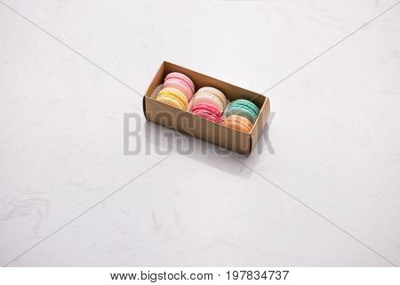 Sweet macarons. Different french cookies macaroons in a paper box.