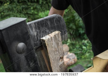 Firewood split with wooden splitter in the garden