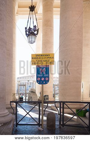 VATICAN CITY VATICAN - OCTOBER 16 2016: information shield in front of the piazza san pietro with the famous basilica st. peter