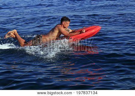Split Croatia - 12 July 2017: Young man enjoying electric jet surfing board kymera bodyboard on the Znjan Beach