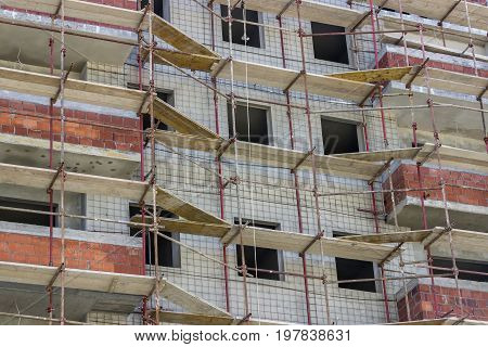 Wall With Scaffolding Background