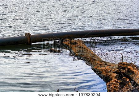 Pipeline plastic pipes float on the water surface.