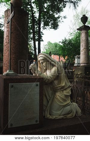 Antique Statue Of Woman On Tomb.