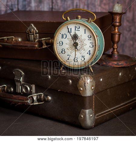 Retro Style Alarm Clock And Suitcases