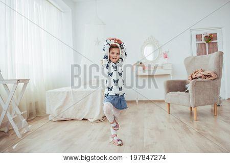 Cute little girl dreams of becoming a ballerina. Girl studying ballet