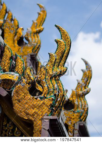 Nagas guarding the roof of the Grand Palace in Bangkok Thailand.
