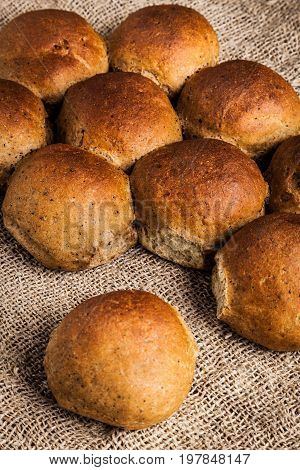 Delicious and healthy wheat-rye buns close-up. Freshly baked peasant bread