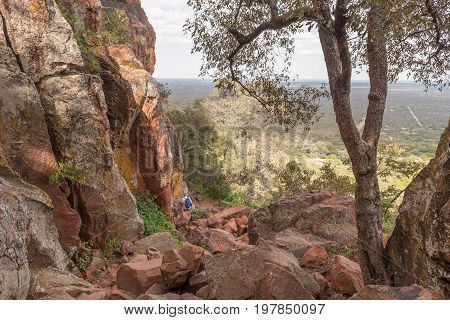 WATERBERG PLATEAU NATIONAL PARK NAMIBIA - JUNE 19 2017: Unidentified tourists on the footpath down from the Waterberg Plateau near Otjiwarongo in the Otjozondjupa Region of Namibia