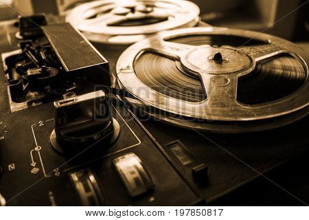 Old tape recorder is playing music close up