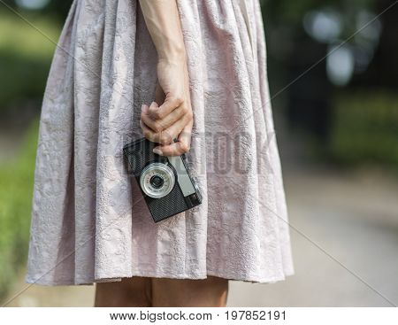 Woman hand holding retro camera close-up. Stock photo