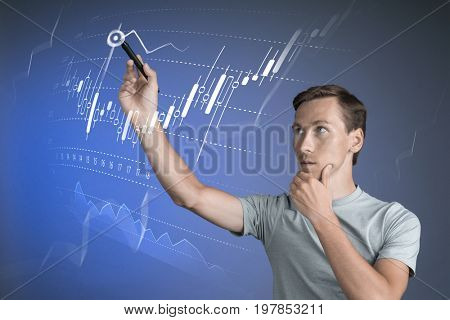 Finance data concept. Man working with Analytics. Chart graph information with Japanese candles on digital screen.