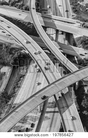 Black and white aerial of the Golden State 5 and Route 118 freeway interchange in the San Fernando Valley area of Los Angeles California.
