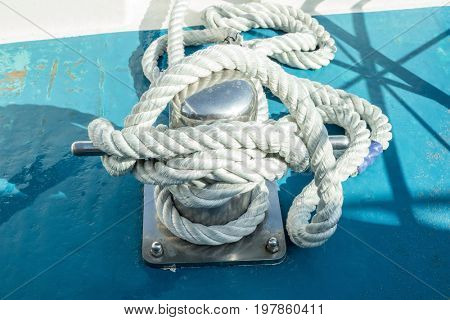Mooring bollard with a fixed rope on the ship