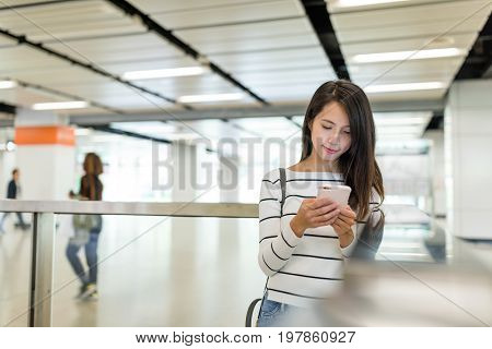 Young Woman holding with mobile phone