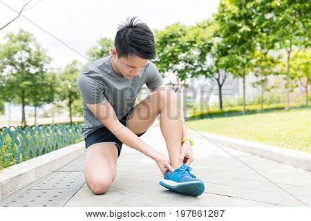Sport man getting hurt on legs