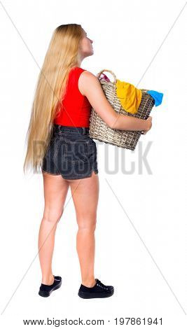Back view of woman with  basket of dirty laundry. girl is engaged in washing. Rear view people collection. Isolated over white background. Long-haired blonde with a laundry basket