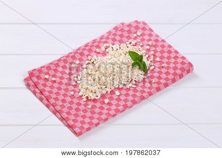 pile of puffed buckwheat on checkered place mat