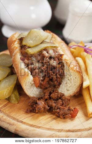 Sloppy Joe's ground beef sandwich with pickles and french fries