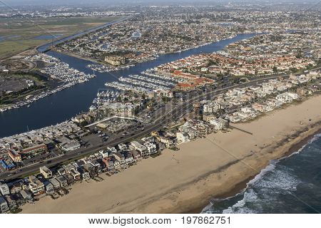 Aerial of Sunset Beach ocean front homes in Orange County, California.