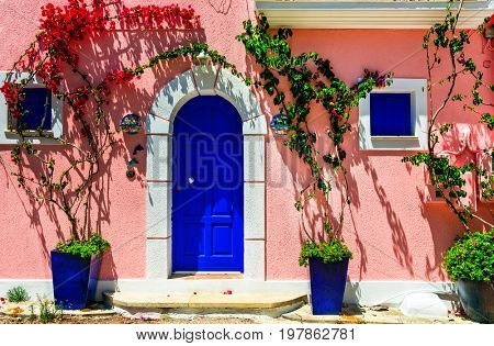 Colorful charming streets of old towns of Greece. Assos in Kefalonia