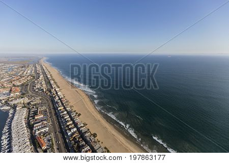 Aerial of Sunset Beach and Pacific Coast Highway in Orange County, California.