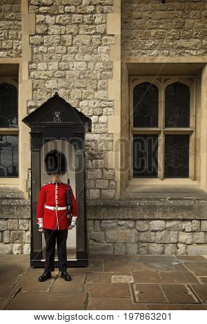 LONDON, UK - JUNE 7 , 2017: Royal Guard in Tower of London are the names given to contingents of infantry and cavalry soldiers charged with guarding the official royal residences in the United Kingdom