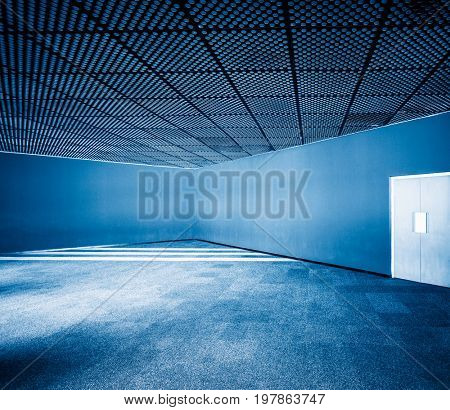 empty corner space with ceiling,blue toned,china.