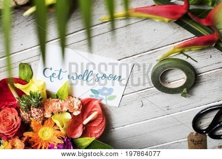 Flower bouquet with get well soon card