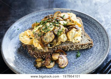 Scrambled eggs and mushrooms on wholewheat toast.