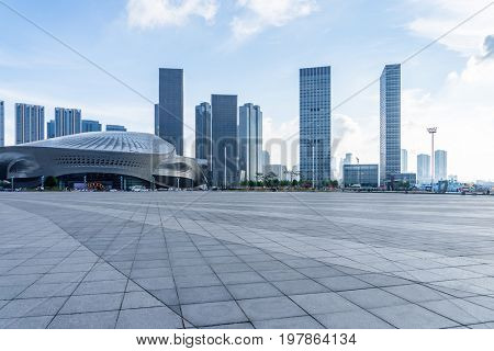 empty square and city skyline under blue sky,tianjin city,china.