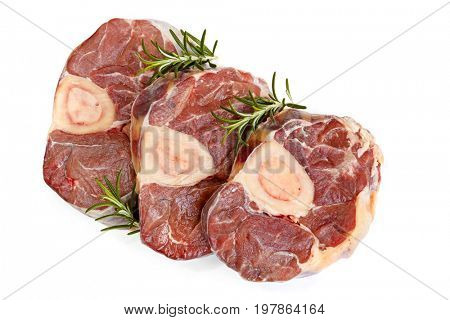 Raw osso bucco veal shanks, top view, isolated on white.
